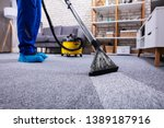 human cleaning carpet in the... | Shutterstock . vector #1389187916