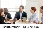 multiracial businesspeople sit... | Shutterstock . vector #1389203009