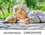 Lovely Happy Boy With Turtle
