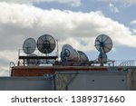 Industrial Satellite dishes, communication signal on the roof of the building. Telecentre Building St. Petersburg