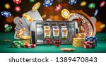 Online casino. Smartphone or mobile phone, slot machine, dice, cards and roulette on a green table in casino. 3d illustration - stock photo