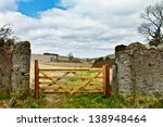 Wooden Gate In A Stone Wall On...
