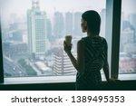 businesswoman drinking coffee... | Shutterstock . vector #1389495353
