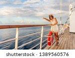 happy cruise vacation fun... | Shutterstock . vector #1389560576