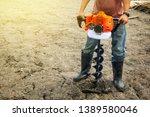 Farmer Using Tools Hand Held...