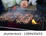 makes shish kebab from fresh... | Shutterstock . vector #1389630653