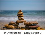 cairn on sea background. pyramid | Shutterstock . vector #1389634850