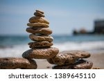 cairn on sea background. pyramid | Shutterstock . vector #1389645110