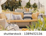 patterned pillows on a wicker... | Shutterstock . vector #1389652136