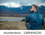seated young casual man... | Shutterstock . vector #1389696230