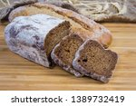 partly sliced dark brown bread... | Shutterstock . vector #1389732419