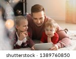 young father with little...   Shutterstock . vector #1389760850
