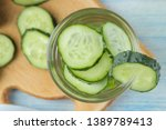 water with cucumber. refreshing ... | Shutterstock . vector #1389789413