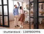 happy young couple dancing at... | Shutterstock . vector #1389800996