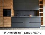 he modern kitchen is combined... | Shutterstock . vector #1389870140