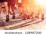 Small photo of Marathon running race people competing in fitness and healthy active lifestyle feet on road