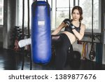 young asian athlete woman with... | Shutterstock . vector #1389877676