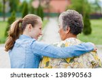 elderly woman tell her... | Shutterstock . vector #138990563