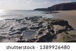 volcanic rock beach in... | Shutterstock . vector #1389926480