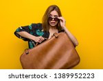young woman holding a leather... | Shutterstock . vector #1389952223
