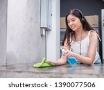 young happy asia housewife... | Shutterstock . vector #1390077506