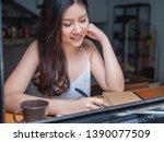 indoor picture of smiling asia... | Shutterstock . vector #1390077509