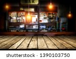 Stock photo desk of free space for your decoration and blurred background of bar 1390103750