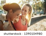 two fit young women in... | Shutterstock . vector #1390104980