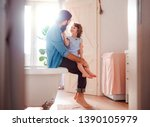 a small girl with young father... | Shutterstock . vector #1390105979