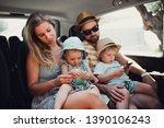 a young family with two toddler ... | Shutterstock . vector #1390106243