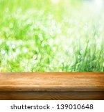 empty table and fresh green... | Shutterstock . vector #139010648