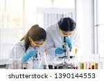 female  scientists are... | Shutterstock . vector #1390144553