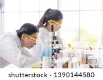 female  scientists are... | Shutterstock . vector #1390144580