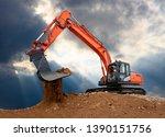 Excavator Works In Constructio...