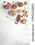 Various Nuts In  Bowls On Whit...