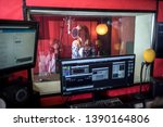Female singer during vocal recording at music studio - stock photo