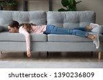 Full Length Of Girl Lying Rest...