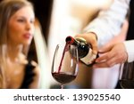 waiter pouring red wine to a... | Shutterstock . vector #139025540