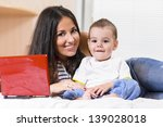 mother and son are using laptop ... | Shutterstock . vector #139028018