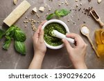Woman Mixing Pesto Sauce With...