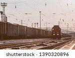 the locomotive moves along the... | Shutterstock . vector #1390320896