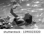 refreshment and swimming in... | Shutterstock . vector #1390323320