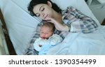 mother and baby together after... | Shutterstock . vector #1390354499