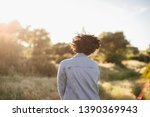 back portrait of young woman... | Shutterstock . vector #1390369943