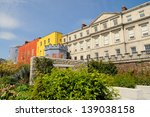Small photo of Colorful buildings of Dublin Castle from Dubb Linh gardens in Dublin, Ireland on a sunny spring day