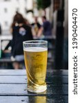 pint of cider on an outside... | Shutterstock . vector #1390404470