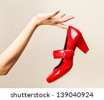 Woman Hand Holding Dress Red...