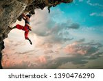 athletic woman climbing on... | Shutterstock . vector #1390476290