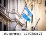 Flag of the agentina in the midst of the old city building - Image