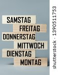 Small photo of A list of wooden blocks lying on top of each other with a list of days of the six-day work week in German, in the translation of the word: saturday, friday, thursday, wednesday, tuesday, monday
